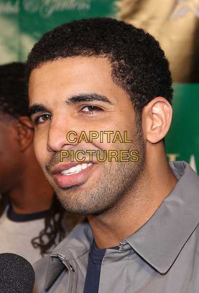 DRAKE (Aubrey Drake Graham).Grand Opening of Chateau Nightclub inside the Paris Resort Hotel and Casino,  Las Vegas, Nevada, USA, .5th March 2011..portrait headshot stubble facial hair smiling  grey gray .CAP/ADM/MJT.© MJT/AdMedia/Capital Pictures.