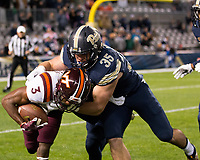 Pitt running back George Aston makes a tackle on Virginia Tech kickoff return man Greg Stroman. The Virginia Tech Hokies defeated the Pitt Panthers 39-36 on October 27, 2016 at Heinz Field in Pittsburgh, Pennsylvania.