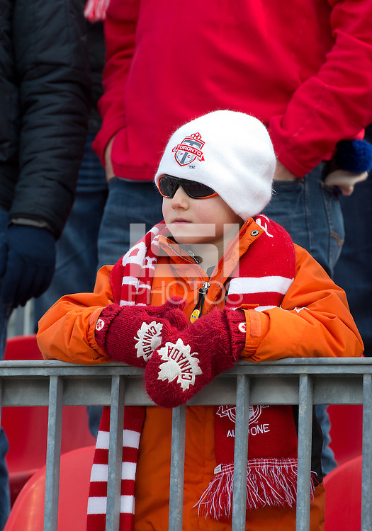 06 April 2013: A young Toronto FC fan watches the action during an MLS game between FC Dallas and Toronto FC at BMO Field in Toronto, Ontario Canada..The game ended in a 2-2 draw..