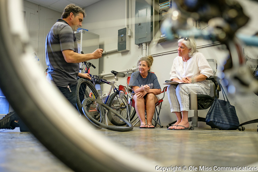 Bicycle technician Stephen Valliant shows how to repair a flat tire in a bike maintenance class as part of Staff Appreciation Week. Photo by Robert Jordan/Ole Miss Communications