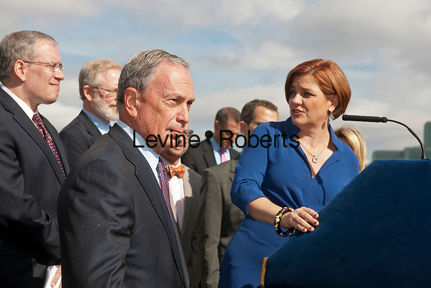 NY Mayor Mike Bloomberg (L) listens as City Council Speaker Christine Quinn (R) speaks at the groundbreaking ceremony for the third segment of the High Line Park, covering West 30th to West 34th Streets in New York, on Thursday, September 20, 2012.The final phase of the popular park is scheduled to open in 2014 and over ten million visitors have toured the park since its opening in 2009.   (© Richard B. Levine)