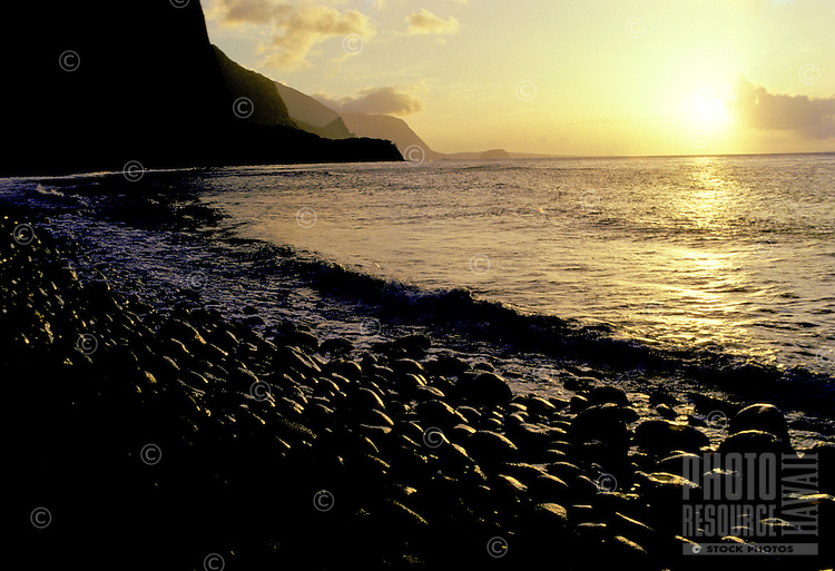 The remote coastline of Molokai's north shore at sunrise shot from Wailau Valley.