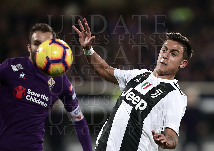 Calcio, Serie A: Fiorentina - Juventus, stadio Artemio Franchi Firenze 1 dicembre 2018.<br /> Juventus' Paulo Dybala (r) in action with Fiorentina's captain German Pezzella (l) during the Italian Serie A football match between Fiorentina and Juventus at Florence's Artemio Franchi stadium, December 1, 2018.<br /> UPDATE IMAGES PRESS/Isabella Bonotto