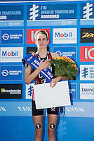 12 JUL 2014 - HAMBURG, GER - Gwen Jorgensen (USA) listens to the American national anthem being played during the medal ceremony after she had won the women's 2014 ITU World Triathlon Series round in the Altstadt Quarter, Hamburg, Germany (PHOTO COPYRIGHT © 2014 NIGEL FARROW, ALL RIGHTS RESERVED)