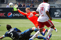 Philadelphia Union goalkeeper Zac MacMath (18) parries a shot. The New York Red Bulls defeated the Philadelphia Union  3-2 during a Major League Soccer (MLS) match at PPL Park in Chester, PA, on May 13, 2012.