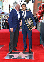 LOS ANGELES, CA. November 16, 2018: Michael Buble & Bruce Allen at the Hollywood Walk of Fame Star Ceremony honoring singer Michael Bublé.<br /> Pictures: Paul Smith/Featureflash
