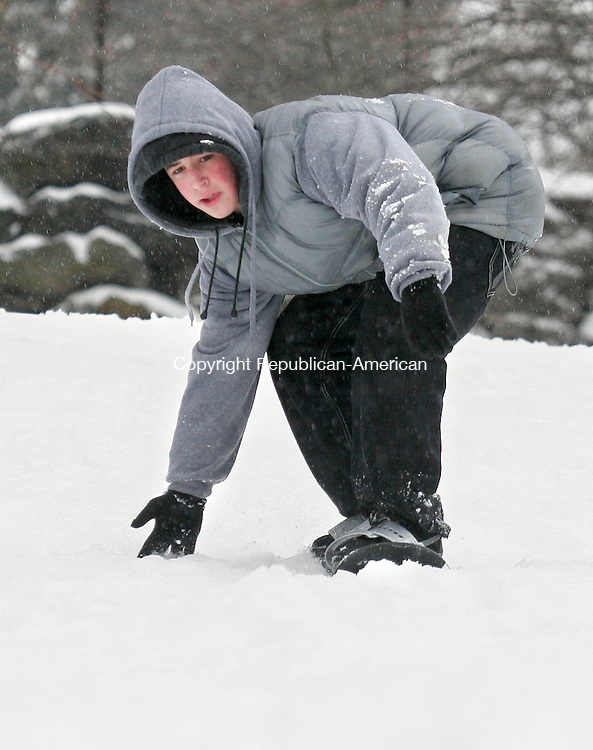 WATERBURY, CT-28 JANUARY 2009-012809BF06-- David Yorker, 13, from Waterbury uses his snowboard on a hill at Fulton Park in Waterbury Wednesday afternoon following a snowstorm that closed schools in the region. Bob Falcetti Republican-American