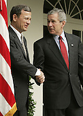Washington, D.C. - July 20, 2005 -- United States President George W. Bush shakes hands with Supreme Court nominee, John G. Roberts Jr. while speaking to reporters at the White House in Washington, D.C. on July 20, 2005.  If confirmed by the United States Senate,  Roberts would fill the vacancy created by Justice Sandra Day O'Conner who announced her retirement last month..Credit: Mark Wilson - Pool via CNP