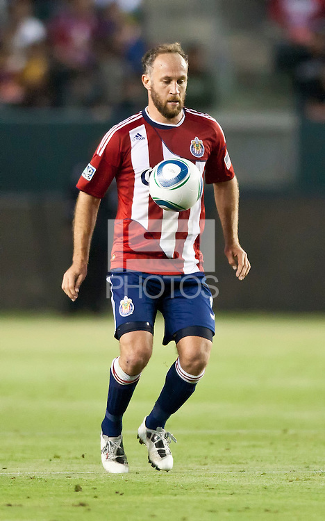 CARSON, CA – June 18, 2011: Chivas USA midfielder Simon Elliott (9) during the match between Chivas USA and FC Dallas at the Home Depot Center in Carson, California. Final score Chivas USA 1, FC Dallas 2.
