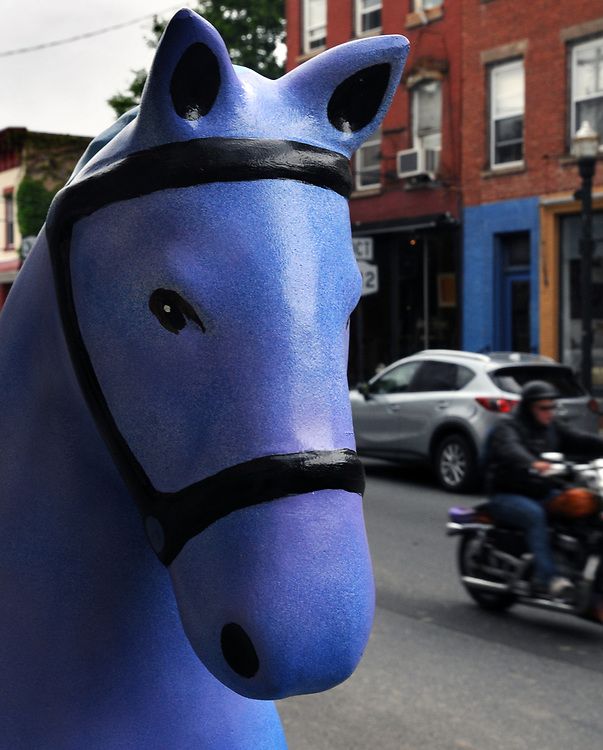 """A view of """"Blue Horse"""" created by, Bill Reinhart, at 110 Partition Street, one of the """"Rockin' Around Saugerties"""" theme Statues on display throughout the Village of Saugerties, NY, on Friday, June 9, 2017. Photo by Jim Peppler. Copyright/Jim Peppler-2017."""