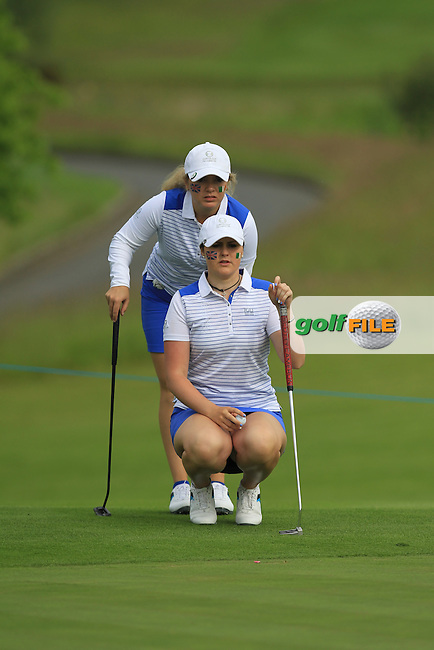 Bronte Law and Olivia Mehaffey on the 4th green during the Friday morning Foursomes of the 2016 Curtis Cup at Dun Laoghaire Golf Club on Friday 10th June 2016.<br /> Picture:  Golffile | Thos Caffrey