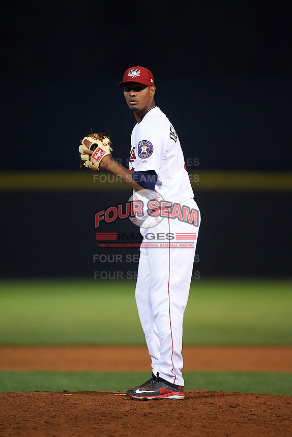 Tri-City ValleyCats pitcher Yeyfry Del Rosario (18) gets ready to deliver a pitch during a game against the Brooklyn Cyclones on September 1, 2015 at Joseph L. Bruno Stadium in Troy, New York.  Tri-City defeated Brooklyn 5-4.  (Mike Janes/Four Seam Images)