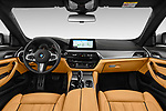 Stock photo of straight dashboard view of a 2018 BMW 5 Series base 4 Door Sedan