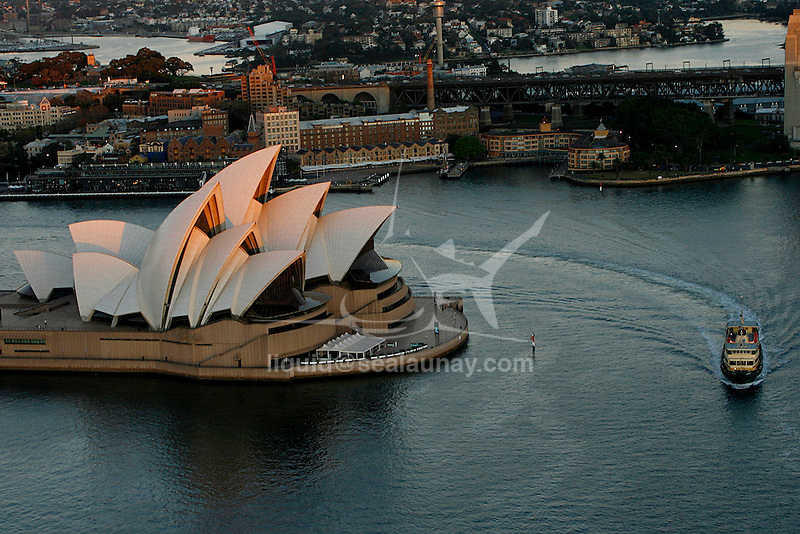 Flight over Sydney.Aerial view of the Sydney Opera House in Australia, early in the morning.