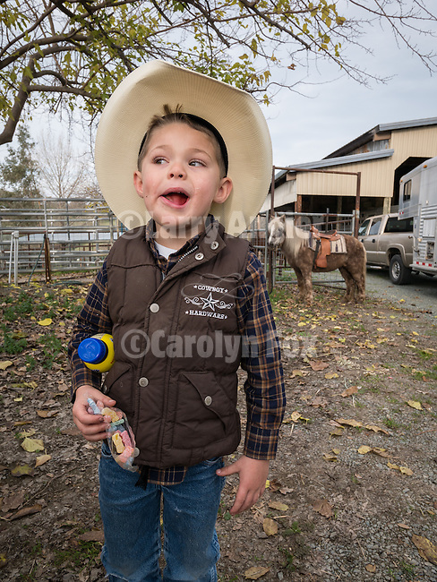 The  Lopes cattle outfit brands and doctors their calves at the Church Bell Hill ranch, Amador County, California, in winter.<br /> <br /> Chase Dugo, age 4, son of Rob and Katrina Dugo of Knights Ferry, Calif., with his pony Smokey