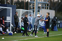 Referee Kristo Tohver tries to calm down the Montpellier Coach, Frederic Garny during Chelsea Under-19 vs Montpellier HSC Under-19, UEFA Youth League Football at the Cobham Training Ground on 13th March 2019