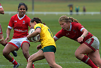 Emily Belchos tackles Cobie-Jane Morgan during the 2017 International Women's Rugby Series rugby match between Canada and Australia Wallaroos at Smallbone Park in Rotorua, New Zealand on Saturday, 17 June 2017. Photo: Dave Lintott / lintottphoto.co.nz