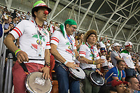 SARANSK, RUSSIA - June 25, 2018: Iran fans drum during the 2018 FIFA World Cup group stage match between Iran and Portugal at Mordovia Arena.