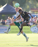 Amanda Cinalli (15) and Formiga (31) jump to head the ball. St. Louis Athletica defeated FC Gold Pride 1-0 at Buck Shaw Stadium in Santa Clara, California on July 5, 2009.