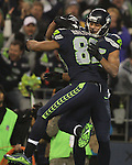 Seattle Seahawks wide receiver Jermaine Kearse (15) celebrates with Doug Baldwin (89) after scoring on a 63 yard touchdown pass against the Carolina Panthers in the NFC Western Division Playoffs  at CenturyLink Field in Seattle, Washington on January 10, 2015.  The Seahawks beat the Panthers 31-17. ©2015. Jim Bryant Photo. All Rights Reserved.The Seahawks beat the Panthers 31-17. ©2015. Jim Bryant Photo. All Rights Reserved.