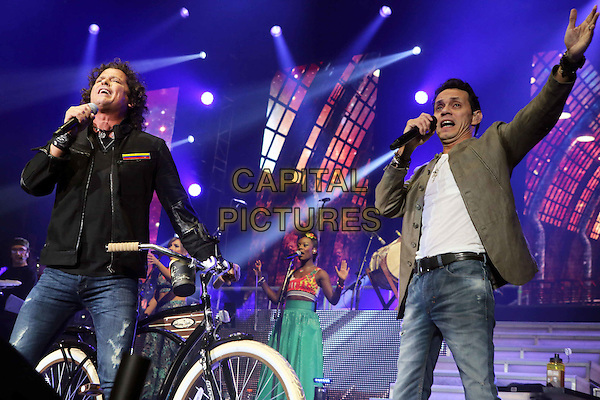 ATLANTA, GA- September 27: Carlos Vives and Marc Anthony perform on Sept. 27, 2015 at Philips Arena in Atlanta. <br /> CAP/MPI/COH<br /> &copy;COH/MPI/Capital Pictures