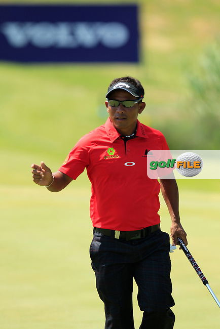 Thongchai Jaidee (THA) sinks his birdie putt on the 2nd green during Sunday Afternoon's Final Match of the 2013 Volvo World Matchplay Championship held  at the Thracian Cliffs Golf & Beach Resort, Kavarna, Bulgaria, 19th May 2013..Picture: Eoin Clarke www.golffile.ie.