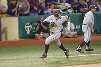 Texas A&M Aggies outfielder J.B. Moss (11) rounds third base and heads home during a Southeastern Conference baseball game against the LSU Tigers on April 24, 2015 at Alex Box Stadium in Baton Rouge, Louisiana. LSU defeated Texas A&M 9-6. (Andrew Woolley/Four Seam Images)