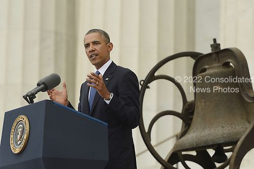US President Barack Obama delivers remarks in front of a freedom bell during the 'Let Freedom Ring' commemoration event, at the Lincoln Memorial in Washington DC, USA, 28 August 2013. The event was held to commemorate the 50th anniversary of the 28 August 1963 March on Washington led by the late Dr. Martin Luther King Jr., where he famously gave his 'I Have a Dream' speech.<br /> Credit: Michael Reynolds / Pool via CNP