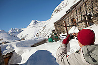 A visitor takes photographs at LEcot, a hamlet close to Bonneval sur Arc, Savoie, France, 17 February 2012.