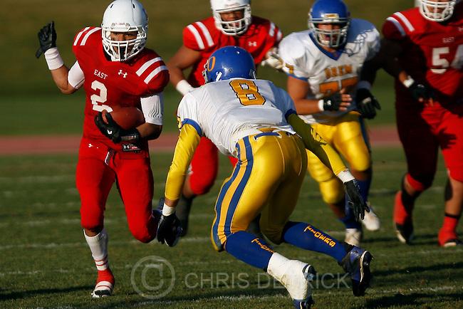 Chris Detrick  |  The Salt Lake Tribune.East's Liti Molisi (2) runs past Orem's Kaleb Egbert (8) during the game at East High School Friday October 28, 2011.  East won the game 31-13.