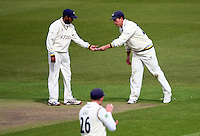 PICTURE BY VAUGHN RIDLEY/SWPIX.COM - Cricket - County Championship Div 2 - Yorkshire v Essex, Day 3 - Headingley, Leeds, England - 21/04/12 - Yorkshire's Joe Sayers passes a note to Adil Rashid.