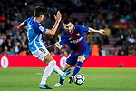 Lionel Andres Messi (r) of FC Barcelona fights for the ball with Adrian Gonzalez Morales of Malaga CF during the La Liga 2017-18 match between FC Barcelona and Malaga CF at Camp Nou on 21 October 2017 in Barcelona, Spain. Photo by Vicens Gimenez / Power Sport Images