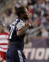 New England Revolution midfielder Joseph Niouky (23) shows his disappointment after being ejected from the game in the second half.  The New England Revolution drew FC Dallas 1-1, at Gillette Stadium on May 1, 2010