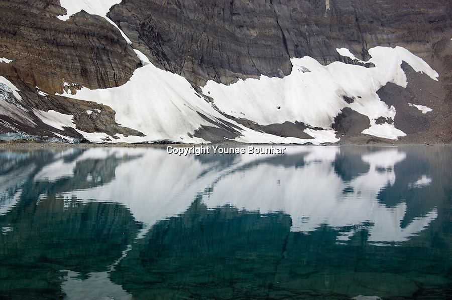 Abstract reflection of the rockwall in the glacial turquoise waters of Floe Lake, Kootenay National Park.