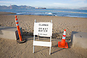 A do not enter sign stands guard at the Crissy Field beach while a container ship in the distance enters the San Francisco Bay (11/12/07). On November 7, 2007 the Cosco Busan container ship spilled an estimated 58,000 gallons of bunker fuel into San Francisco Bay after striking a tower of the San Francisco-Oakland Bay Bridge.