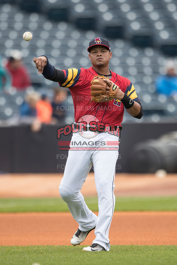 Toledo Mud Hens third baseman Argenis Diaz (11) makes a throw to first base against the Lehigh Valley IronPigs during the International League baseball game on April 30, 2017 at Fifth Third Field in Toledo, Ohio. Toledo defeated Lehigh Valley 6-4. (Andrew Woolley/Four Seam Images)