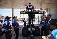 May 7, 2017; Commerce, GA, USA; Crew members make a rear wing adjustment to the dragster of NHRA top fuel driver Shawn Langdon during the Southern Nationals at Atlanta Dragway. Mandatory Credit: Mark J. Rebilas-USA TODAY Sports