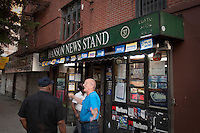 People chat in front of a corner shop in the New York City borough of Brooklyn, NY, Monday August 1, 2011.