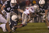 08 October 2005:  Penn State's Chris Harrell (27), Dan Connor (40), and Paul Posluszny (31) close in on  Ohio State RB Antonio Pittman (25)..The Penn State Nittany Lions knocked off the #6 Ohio State Buckeyes 17-10 October 8, 2005 at Beaver Stadium in State College, PA..
