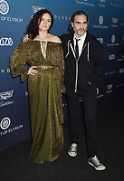 LOS ANGELES, CA - JANUARY 05: Rain Phoenix (L) and Joaquin Phoenix attend Michael Muller's HEAVEN, presented by The Art of Elysium at a private venue on January 5, 2019 in Los Angeles, California.<br /> CAP/ROT/TM<br /> ©TM/ROT/Capital Pictures