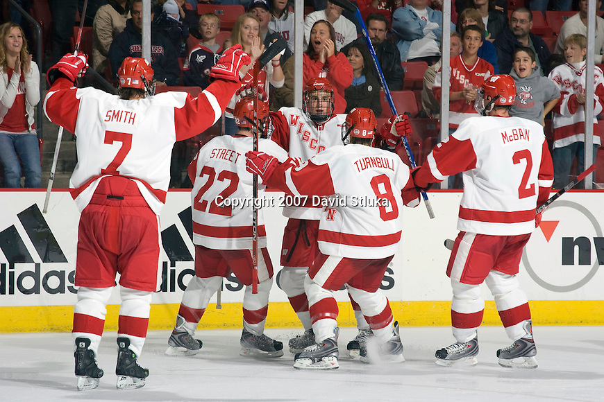 MADISON, WI - OCTOBER 19: The Wisconsin Badgers men's hockey team celebrates a goal against the Robert Morris Colonials at the Kohl Center on October 19, 2007 in Madison, Wisconsin. The Badgers beat the Colonials 7-2. (Photo by David Stluka)