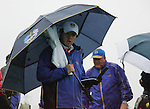 Rory McIlroy takes shelter from the horrendous weather during the morning Fourball Match 2  during Day 1 of the The 2010 Ryder Cup at the Celtic Manor, Newport, Wales, 29th September 2010..(Picture Eoin Clarke/www.golffile.ie)