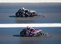 Nov 3, 2019; Las Vegas, NV, USA; NHRA pro stock motorcycle rider Matt Smith (near) against Katie Sullivan during the Dodge Nationals at The Strip at Las Vegas Motor Speedway. Mandatory Credit: Mark J. Rebilas-USA TODAY Sports