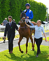 Winner of The Smith & Williamson Fillies' Novice Stakes (Class 5)) Tamreer ridden by Dane O'Neil and trained by Charles Hills is led into the winners enclosure during Afternoon Racing at Salisbury Racecourse on 17th May 2018