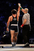 STATE COLLEGE, PA - FEBRUARY 8: Morgan McIntosh of the Penn State Nittany Lions gets his hand raised after defeating Nathan Burak of the Iowa Hawkeyes after their match on February 8, 2015 at the Bryce Jordan Center on the campus of Penn State University in State College, Pennsylvania. The Hawkeyes won 18-12. (Photo by Hunter Martin/Getty Images) *** Local Caption *** Morgan McIntosh