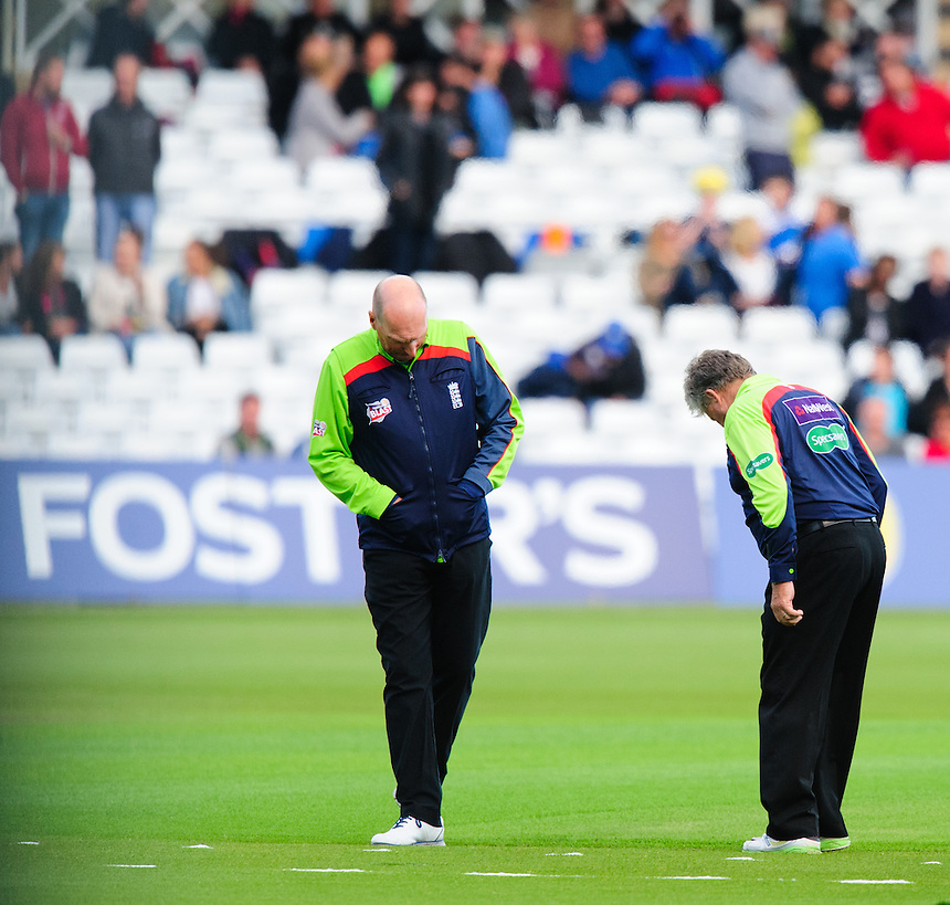 Umpires Neil Mallender, left, and Nigel Cowley, right, come out to inspect the Trent Bridge wicket after a heavy downpour of rain delayed the start of play.  The game against Durham Jets was postponed.<br /> <br /> Photographer Chris Vaughan/CameraSport<br /> <br /> County Cricket - NatWest T20 Blast - Notts Outlaws v Durham Jets - Friday 1st July 2016 - Trent Bridge - Nottingham<br /> <br /> &copy; CameraSport - 43 Linden Ave. Countesthorpe. Leicester. England. LE8 5PG - Tel: +44 (0) 116 277 4147 - admin@camerasport.com - www.camerasport.com