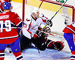 10 February 2010: Washington Capitals' center Brooks Laich scores a goal and slides into the net during first period action against the Montreal Canadiens at the Bell Centre in Montreal, Quebec, Canada. The Canadiens defeated the Capitals 6-5 in sudden death overtime, ending Washington's team-record winning streak at 14 games. Mandatory Credit: Ed Wolfstein Photo
