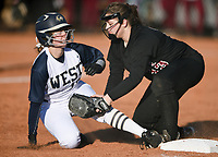 NWA Democrat-Gazette/CHARLIE KAIJO Springdale High School Morgan Thompson (13) tags out Bentonville West High School outfielder Annabelle Bonds (16) at third base during a softball game, Thursday, March 13, 2019 at Bentonville West High School in Centerton.
