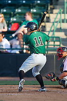 Leonardo Rojas (11) of the Augusta GreenJackets at bat against the Hickory Crawdads at L.P. Frans Stadium on May 11, 2014 in Hickory, North Carolina.  The GreenJackets defeated the Crawdads 9-4.  (Brian Westerholt/Four Seam Images)