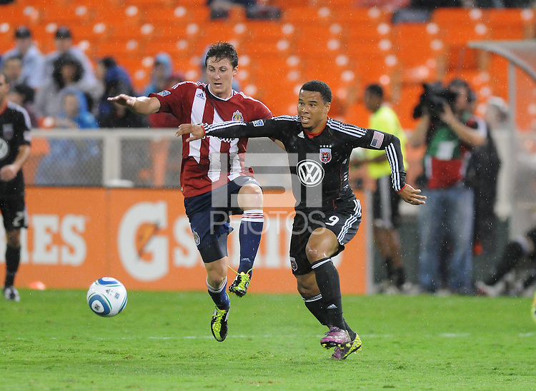 D.C. United forward Charlie Davies (9) shields the ball against Chivas USA midfielder Ben Zemanski (21). Chivas USA tied D.C. United 2-2 at RFK Stadium, Wednesday  September 20 , 2011.
